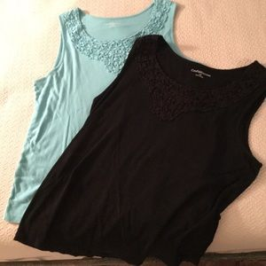 Two sleeveless tops with embroidery detail. 1x